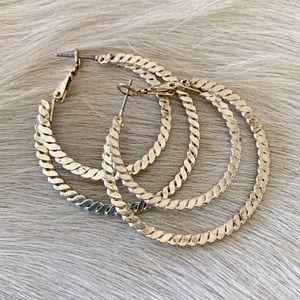 Sterling silver flat-twist double hoop earrings
